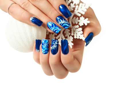 Abstract Christmas design on women's nails. Isolated.