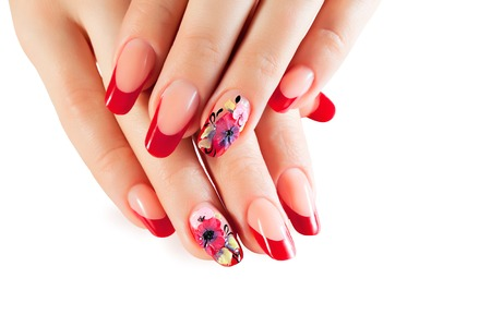 Female hands with red nails and flower design. Stok Fotoğraf
