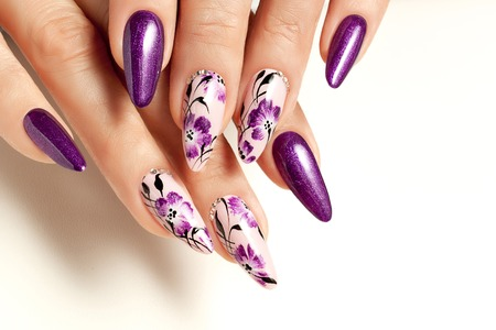 Nail art service. Female manicure and floral patterns. Stock Photo