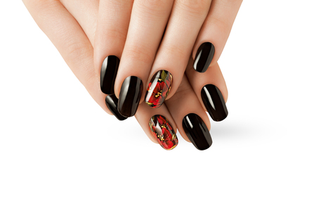 Female hands with red and black nails.