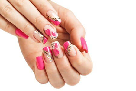 Nail art manicure, with a pattern of flowers and hearts. Isolated.