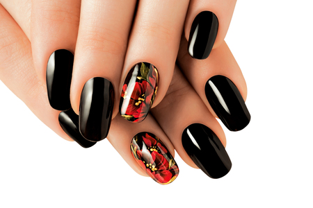 Woman hands with red and black nails. Isolated.