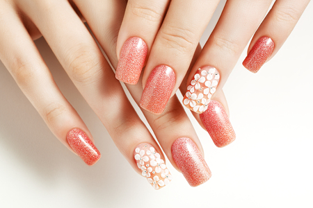 Pink nails. Female manicure and floral patterns. Archivio Fotografico