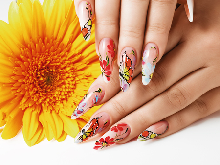 Female hands with summer art design on nails. Stok Fotoğraf