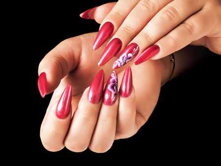 deign: Red nails and floral deign, on black background.