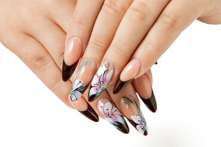 Nail art service. Female manicure and floral patterns. Stok Fotoğraf