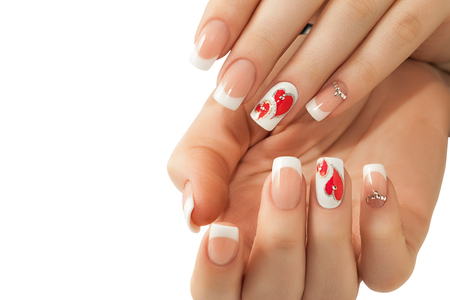 Manicure. White nails with red hearts. Isolated. Stok Fotoğraf