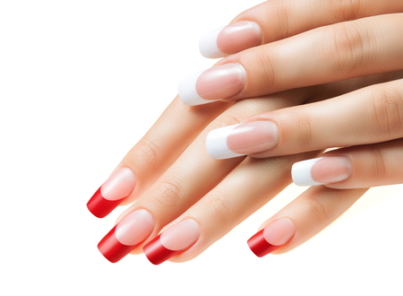 Hands of girls. Female manicure. Red and white nails.