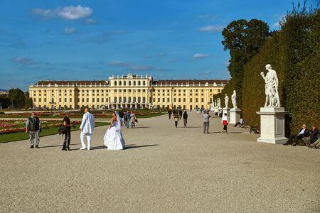 old photo: Vienna, Austria - September 24, 2014: Wedding photo shoot of bride and groom near Schonbrunn palace