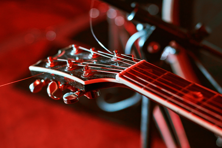 Closeup of guitar fingerboard at concert