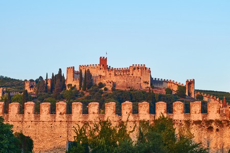 View of beautiful medieval town of Soave, Italy in the evening Stock Photo