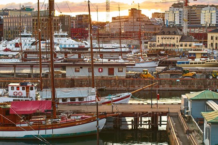 Different ships in the port near the Akershus Castle at the evening in Oslo, Norway