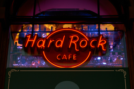 Neon light of the logo of Hard Rock cafe at night.
