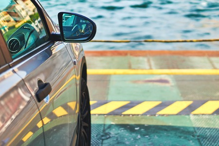 Car parked on the ferry with copy space and water on background