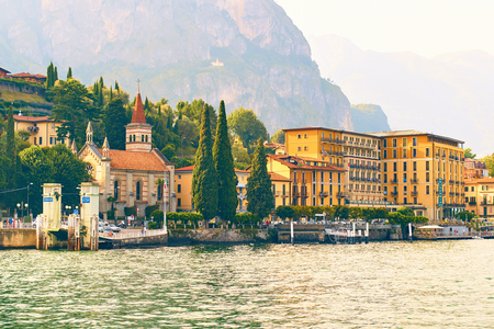 Beautiful view of Cadenabbia di Griante, a small town on the shore of the lake Como with the Anglican Church of the Ascension in Lombardy, Italy Stock Photo