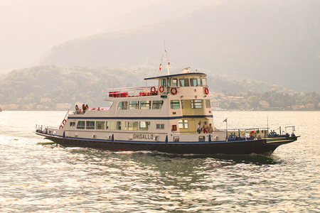 Passenger ship on a regular route across lake Comno arrives to the destination