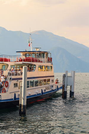 Passenger ship on a regular route across lake Comno ready to leave the quay. Editorial