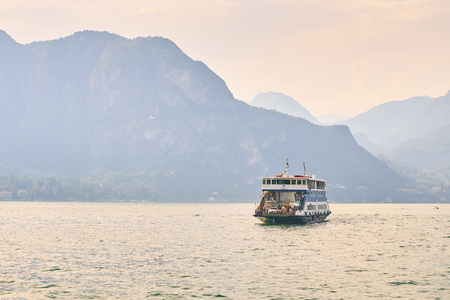 Ferry boat is sailing across the lake Como. Editorial