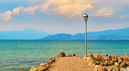 lonely lantern on beautiful lake Garda in Italy Stock Photo