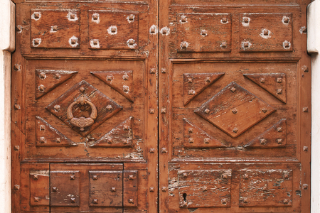 Ancient vintage wooden door with a knocker Stock Photo