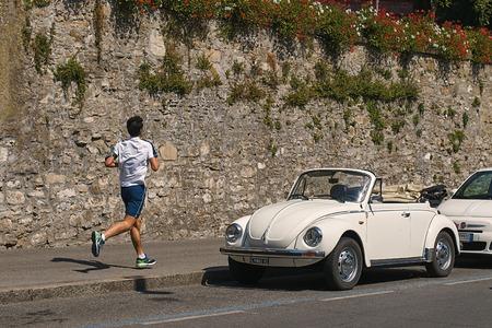 Vintage white Volkswagen VW Beetle cabriolet car Volkswagen Type 1, Volkswagen Bug parked on the street.