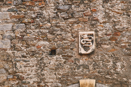 Coat of arms of Swiss city of Bellinzona on the old town wall