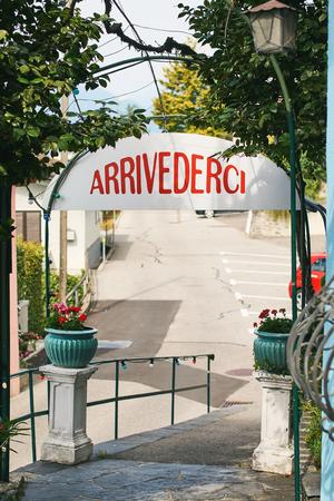 Arrivederci or Goodbye sign in Italian language in rural Switzerland