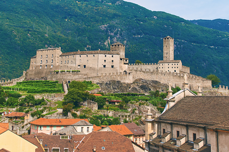 View of beautiful city of Bellinzona in Switzerland with Castelgrande castle from Montebello Stock Photo