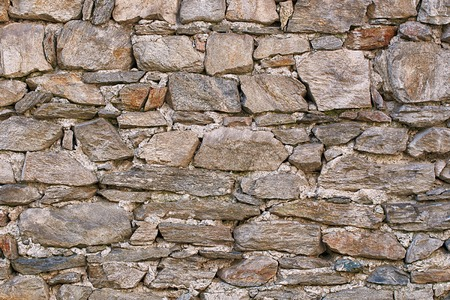Wall made of natural stones background Stock Photo