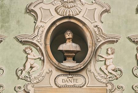 Vintage sculpture portrait of Dante Alighieri on a facade of an old building in Bellinzona, Switzerland Stock Photo