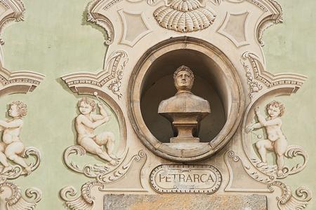 Vintage sculpture portrait of Francesco Petrarca on a facade of an old building in Bellinzona, Switzerland Stock Photo