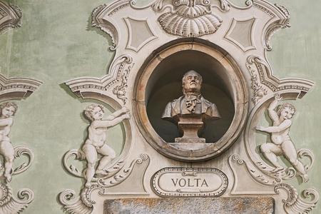 Vintage sculpture portrait of Alessandro Volta on a facade of an old building in Bellinzona, Switzerland
