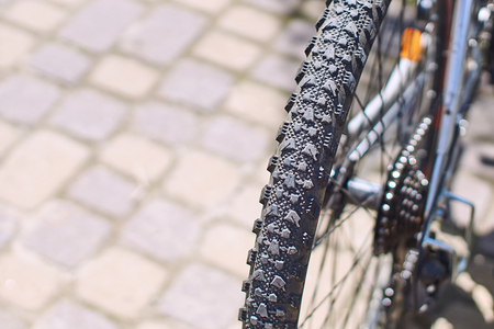 Grooved tire on a mountain bike wheel on a sunny day Stock Photo