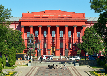 Passers by and students walking in front of the Red University Building or Chervonyi Korpus Universytetu, the principal and oldest 4-story building of Taras Shevchenko National University of Kyiv Editorial