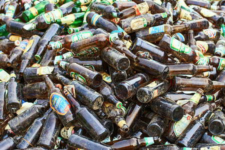Empty glass beer bottles of local Ukrainian manufakturers gathered for recycling.