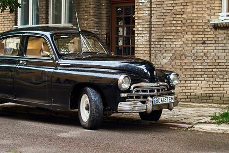 Vintage black GAZ-M20 Pobeda car released circa 1950 in USSR parked on the street