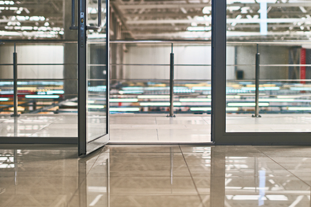 Open door in the modern office or shopping center with bokeh background