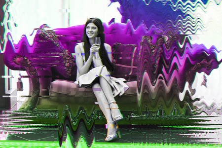 Portrait of a young beautiful woman in black and white sitting on a sofa with a glass of wine in her hand with crazy colorful neon glitch effect Stock Photo