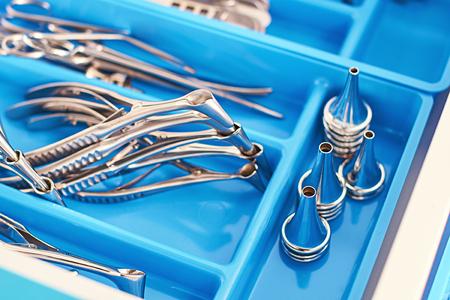 Otorhinolaryngology or ENT surgery instruments in a blue medical box