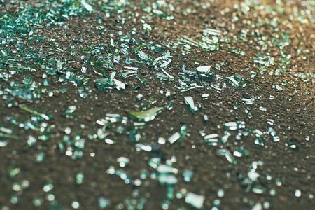 Shards of car glass on the asphalt