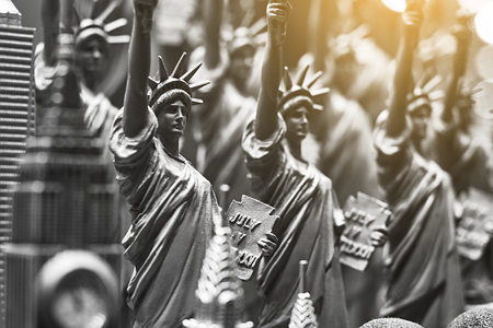 Row with generic Statue of Liberty statues sold as souvenirs in a NYC shop - selective focus. Stock Photo