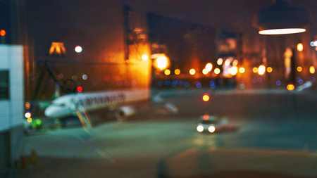 Blurred or defocused beautiful airport terminal early morning or night background with airplane, bokeh lights and glass reflections Stok Fotoğraf - 121639815