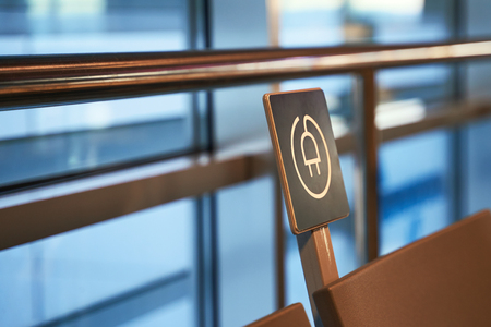 Free battery charging station near seats in the international airport for travelers Stok Fotoğraf