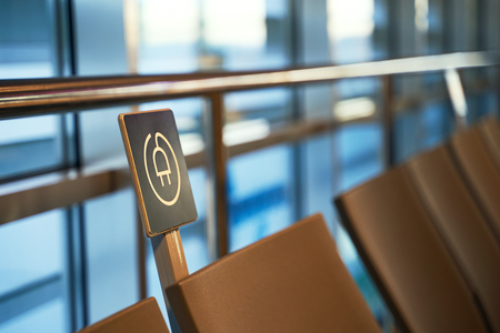Free battery charging station near seats in the international airport for travelers Stok Fotoğraf - 121639821