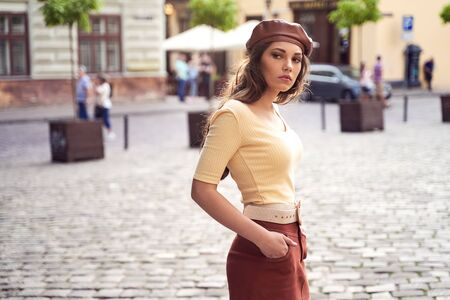 Young beautiful girl dressed in retro vintage style in the old european city Stok Fotoğraf