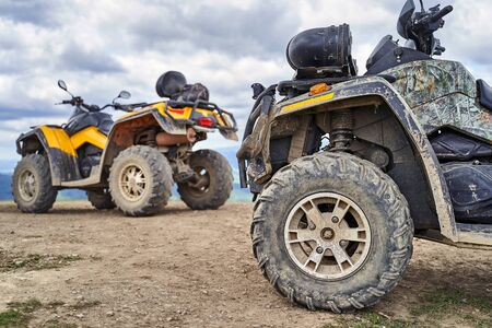 Twi quadricycles or quad bikes on the mountains background on a cloudy day Stok Fotoğraf - 131633885