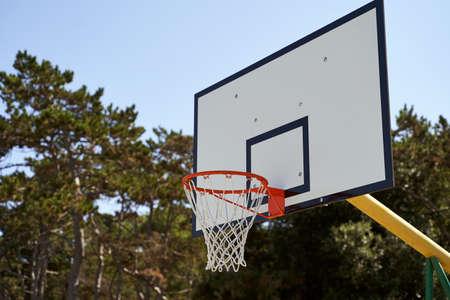 Outdoor basketball hoop or goal on blue sky background. 免版税图像 - 163581060