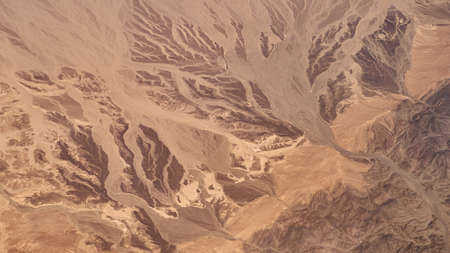 Aerial view of rocky mountains and desert on the south of Sinai Peninsula near Sharm El Sheikh 免版税图像
