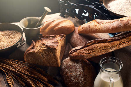 Still life with bread and its ingredients in vintage setting.