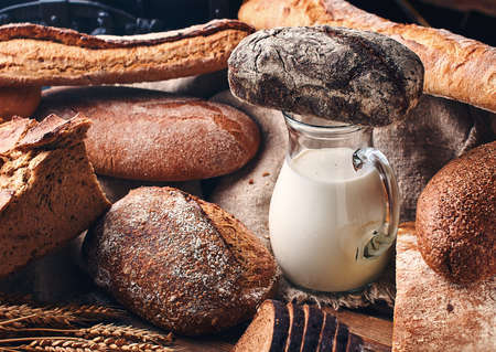 Still life with bread and milk in vintage setting 免版税图像